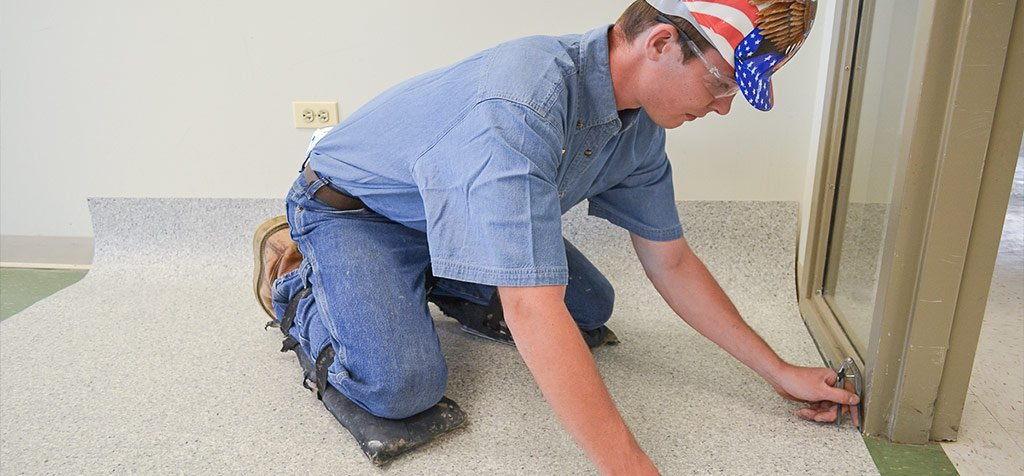 flooring installer working with resilient