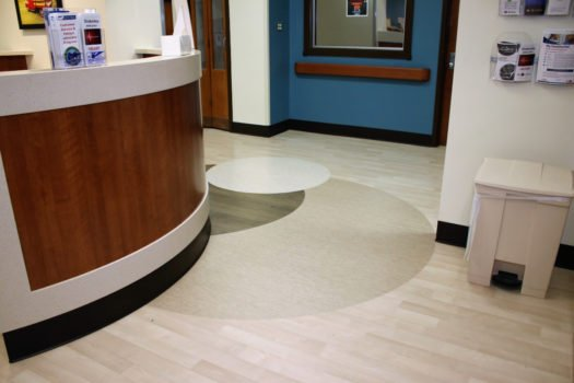 United States Department of Veterans Affairs NIHCS Fort Wayne Campus front desk detail flooring installation project by INSTALL